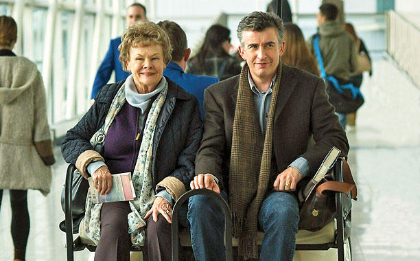 "Philomena travelling through the airport in style with ""Martin Sixsmith - News at 10."""